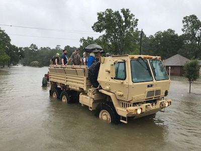 Texas Army National Guard members from the 386th Engineer Battalion partner with first responders from Texas Task Force 1 and the Cypress Creek Fire Department to move residents from severely flooded neighborhoods to safety days after Hurricane Harvey hit south Texas, Aug. 29, 2017. Texas Army National Guard photo by Capt. Martha Nigrelle