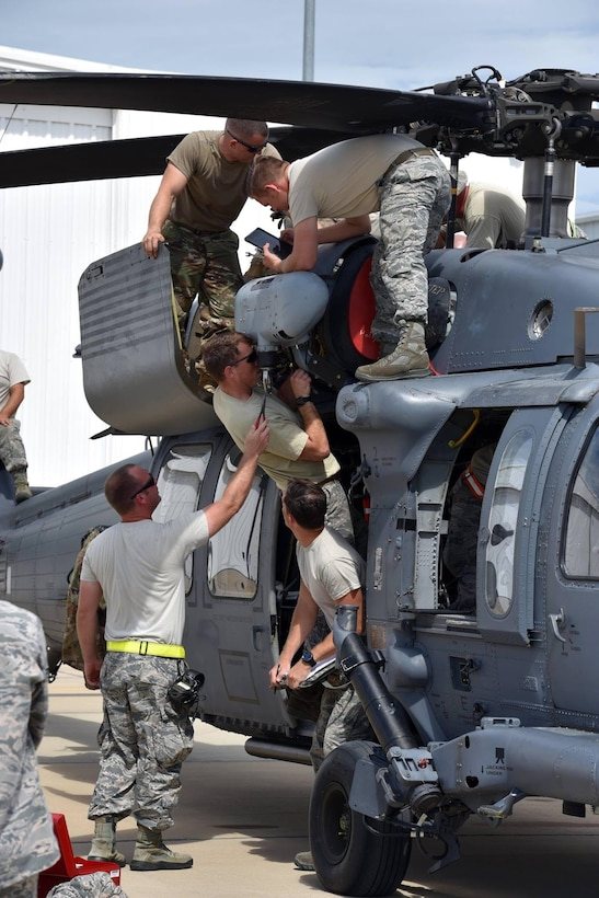 Aircraft maintainers from the 920th Rescue Wing, Patrick Air Force Base, Florida, work at getting an HH-60G Pave Hawk helicopter airport so crews can go rescue stranded people from the floodwaters in Texas. Approximately 94 Citizen Airmen have joined forces with their northern neighbors at Moody Air Force Base, Georgia, the 23rd Rescue Wing, and are operating out of College Station, Texas to rescue people affected by the aftermath of Hurricane Harvey in support of Air Force's Northern search and rescue mission for FEMA disaster relief efforts. (U.S. Air Force photo)