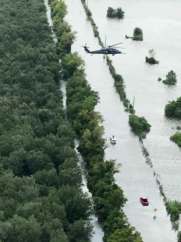 Maj. Jason Tomas, HH-60G Pave Hawk helicopter pilot and his crew rescued five people their first day on the job August 29, 2017. From high above in the sky he saw a hand wave from a submerged white van, it ended up being the local sheriff and two more inside. He and his crew got them all to safety. Rescuing victims from the aftermath of Hurricane Harvey in Texas August 30, 2017. Approximately 94 Citizen Airmen have joined forces with their northern neighbors at Moody Air Force Base, Georgia, the 23rd Rescue Wing, and are operating out of College Station, Texas to rescue people affected by the aftermath of Hurricane Harvey in support of Air Force's Northern search and rescue mission for FEMA disaster relief efforts. (U.S. Air Force photo)