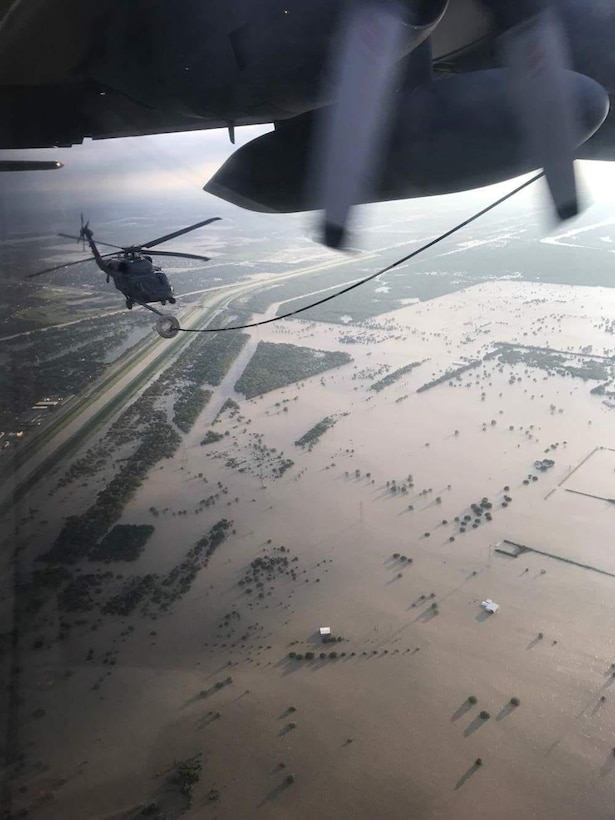 A 920th HH-60G Pave Hawk helicopter crew refuels from a wing HC-130P/N King refueler in-between rescuing victims from the aftermath of Hurricane Harvey in Texas August 30, 2017. Approximately 94 Citizen Airmen have joined forces with their northern neighbors at Moody Air Force Base, Georgia, the 23rd Rescue Wing, and are operating out of College Station, Texas to rescue people affected by the aftermath of Hurricane Harvey in support of Air Force's Northern search and rescue mission for FEMA disaster relief efforts. (U.S. Air Force photo)