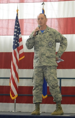 Col. Edwards, the 28th Bomb Wing Commander, delivers a speech to Airmen during Wingmen Day Aug. 25, 2017 on Ellsworth Air Force Base, S.D. The Wing Commanders All Call and kicked off the day's events which included lectures and a base picnic called the Summer Bash. (U.S. Air Force photo by Airman 1st Class Thomas Karol)