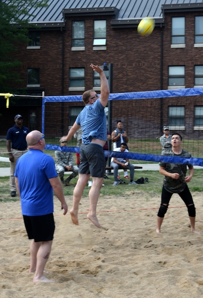 CMSgt. Adam Vizi, the 28th Bomb Wing command chief, hits a volleyball over a net Aug. 25, 2017 on Ellsworth Air Force Base, S.D. Wingmen Day included a base picnic called the Summer Bash where food and beverages were served and senior NCOs played a volley ball game against Airmen. (U.S. Air Force photo by Airman 1st Class Thomas Karol)