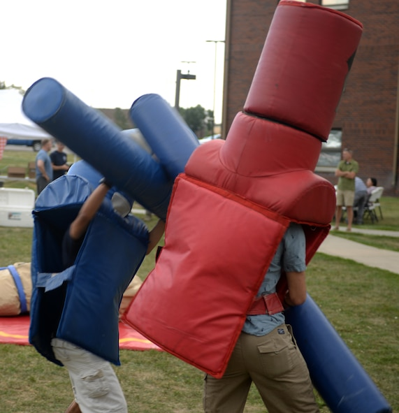 Two Airman challenge each other with pugil sticks at the Summer Bash picnic Aug. 25, 2017 on Ellsworth Air Force Base, S.D. There were multiple games played at the base picnic, including wrestling in Sumo suits, cornhole, horseshoe tossing, and volleyball. (U.S. Air Force photo by Airman 1st Class Thomas Karol)