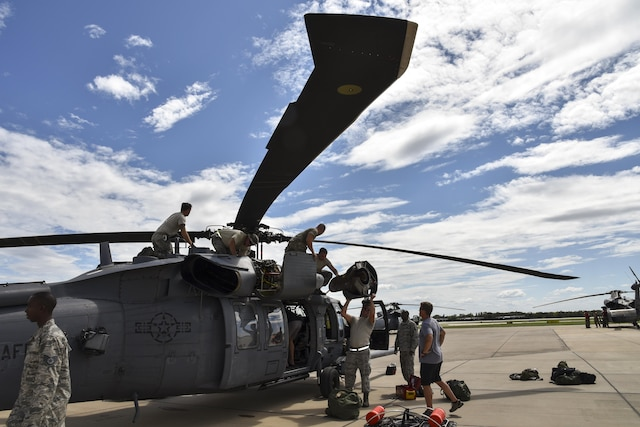 Airmen prepare a Pave Hawk helicopter for a rescue mission.