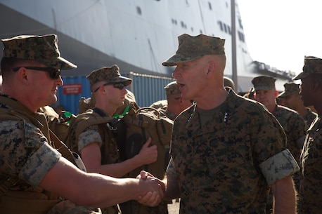 Lt. Gen. Mark A. Brilakis, Commander, U.S. Marine Corps Forces Command, greets Marines from the 26th Marine Expeditionary Unit as they prepare to embark on LHD-3 aboard Naval Operating Base Norfolk, Va., Aug. 30. Marines and sailors with the 26th MEU have prepared to provide humanitarian support to the citizens of Texas who were impacted by Hurricane Harvey. (Official Marine Corps Photo by Master Sgt. Ryan O'Hare/Released)