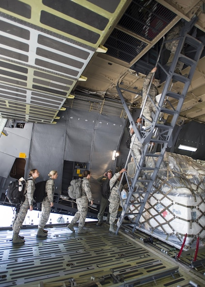 59th Medical Wing members start boarding into a Lockheed C-5 Galaxy as the disaster relief team to Houston, Texas, August 30. More than 70-members of the Air Force's flagship medical wing were mobilized to provide medical attention to the 6 million residents of the greater Houston area, after the city suffered catastrophic flooding due to Hurricane Harvey.