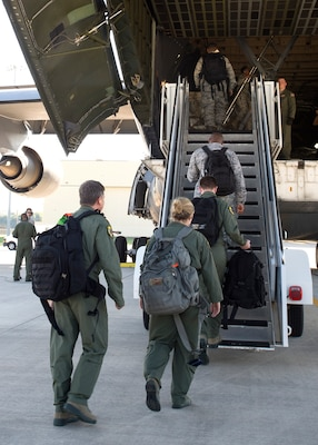 59th Medical Wing members start boarding a Lockheed C-5 Galaxy as the disaster relief team flying into Houston, Texas, August 30. More than 70-members of the Air Force's flagship medical wing were mobilized to provide medical attention to the 6 million residents of the greater Houston area, after the city suffered catastrophic flooding due to Hurricane Harvey.