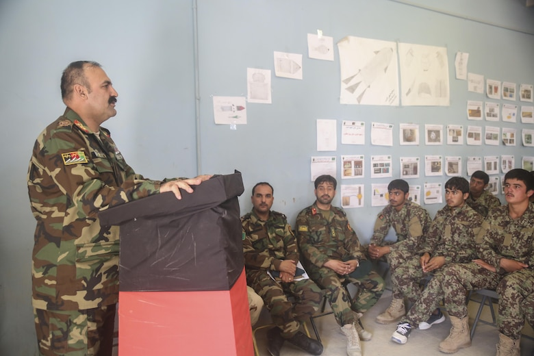 Afghan National Army Maj. Gen. Wali Mohammed Ahmadzai, the commanding general of 215th Corps, speaks to ANA soldiers during a graduation ceremony at Camp Shorabak, Afghanistan, Aug. 30, 2017. The event marked the end of an eight-week route clearance course, which taught approximately 70 soldiers with units from across Helmand province route clearance procedures to help enhance the mobility of supplies and infantry units throughout the region. (U.S. Marine Corps photo by Sgt. Lucas Hopkins)