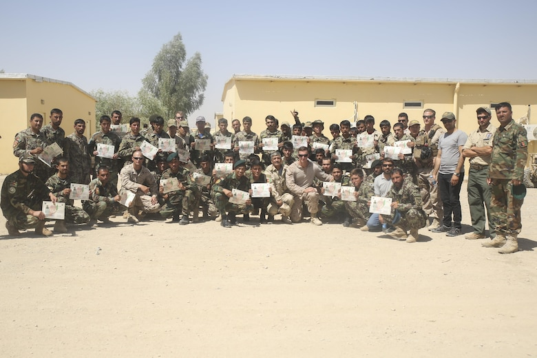 U.S. Marine advisors with Task Force Southwest and Afghan National Army soldiers with 215th Corps pose for a photo following a graduation ceremony at Camp Shorabak, Afghanistan, Aug. 30, 2017. Approximately 70 soldiers with units across Helmand province completed a route clearance course led by U.S. advisors. Throughout the eight-week training program, the soldiers developed their route clearance tactics, techniques and procedures as a means to enhance mobility of troops and supply chains on the battlefield. (U.S. Marine Corps photo by Sgt. Lucas Hopkins)
