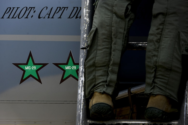 A U.S. Air Force F-15C Eagle pilot from the 493rd Expeditionary Fighter Squadron steps down from his aircraft after arriving at Siauliai Air Base, Lithuania Aug. 29. The United States Air Force is scheduled to assume control of the NATO Baltic Air Policing mission from the Polish air force during a hand-over ceremony on Aug. 30. (U.S. Air Force photo/ Tech. Sgt. Matthew Plew)