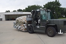 Tech Sgt. Ken Williams transports a palletized load of U.S. Coast Guard assets here on Tuesday. U. S. Coast Guard Air Station Detroit deployed 25 search and rescue crew members to Ellington Field Joint Reserve Base, Houston, to aid in relief efforts in the wake of Hurricane Harvey.