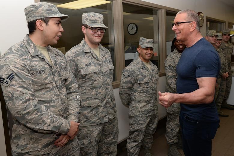 Celebrity chef Robert Irvine talking with Airmen