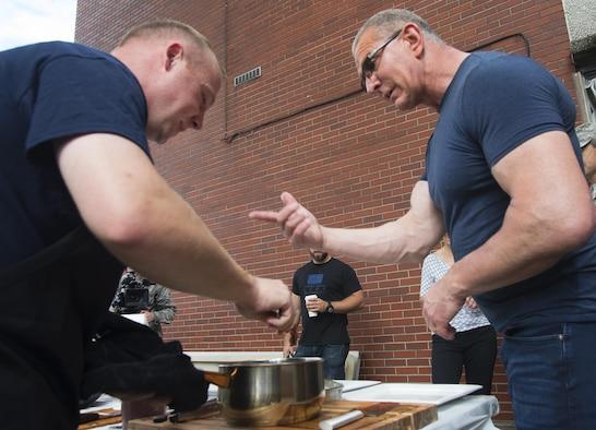 Celebrity Chef Robert Irvine with Master Sgt. Jacob Hellickson