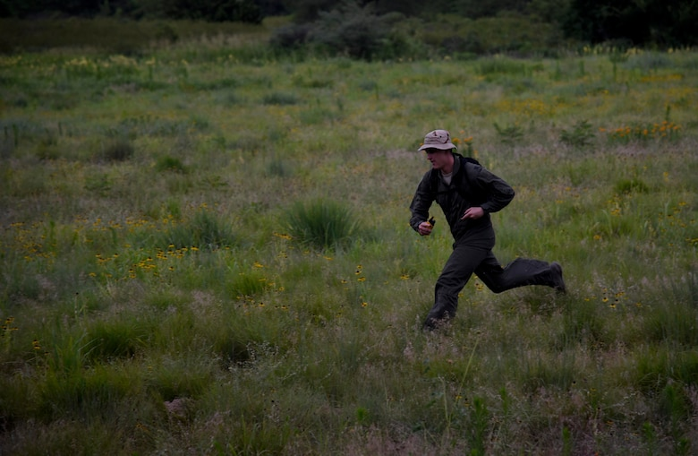 Airman running through field