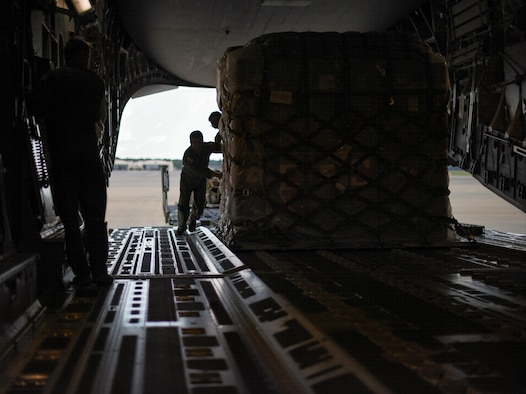 Staff Sgt. Bobby Newman, 43rd Aeromedical Evacuation Squadron aeromedical evacuation technician, guides a pallet of medical supplies onto a Joint Base Charleston C-17 Globemaster III at Pope Army Air Field, N.C., Aug. 30, 2017.