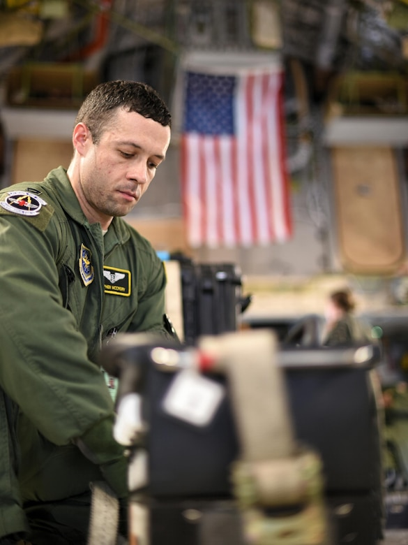 Capt. Stephen McCrory, 43rd Aeromedical Evacuation Squadron flight nurse, secures a generator used to power medical equipment to the inside of a C-17 Globemaster III during a humanitarian assistance and disaster relief mission at Pope Army Air Field, N.C, Aug. 30, 2017.