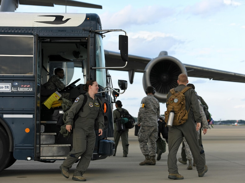 Airmen from the 43rd Aeromedical Evacuation Squadron prepare to board a Joint Base Charleston C-17 Globemaster III at Pope Army Air Field, N.C., Aug. 30, 2017.
