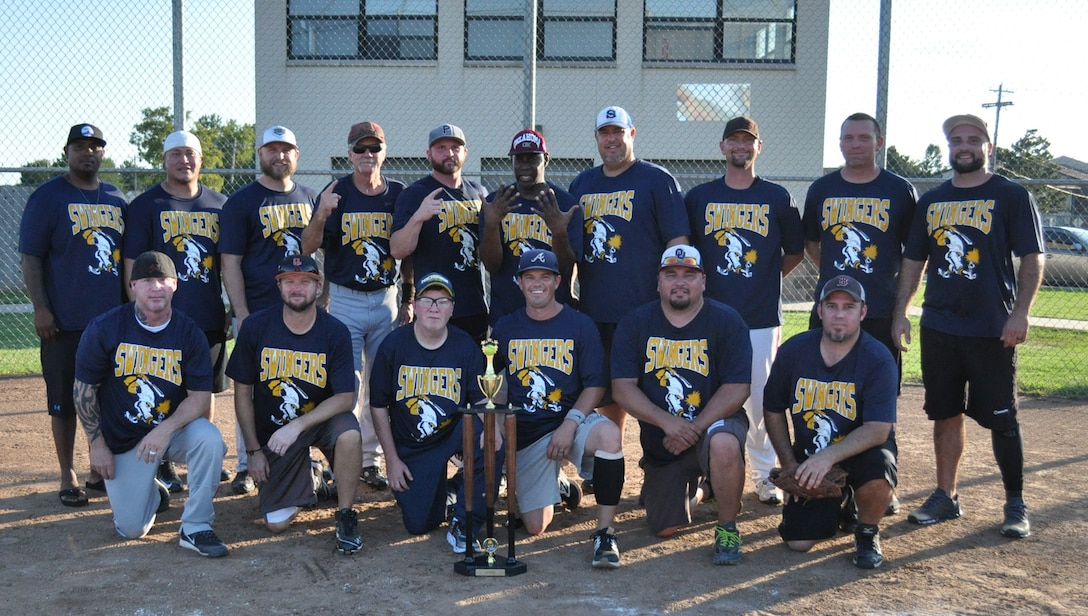 The Swingers gather at home plate Aug. 17 after winning two finals games, 20-15 and 10-6, against Davy Jones for the 2017 Intramural Softball League base championship.