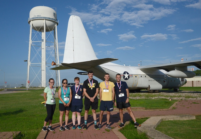 "Top three men's and women's finalists in the annual Howie Shapiro 5K Aug. 18 at the TACAMO complex were YN2 Brianna Bays, VQ-3, third place women's; Anhthu Vo, 557th Software Maintenance Squadron, second place women's; AWV1 Nancy Nichols, VQ-7, first place women's; AE3 Keagan Adams, VQ-4, first place men's; IT2 Dustin Schmidt, SCW-1, second place men's; and Capt. Mike Black, deputy wing commander for SCW-1, third place men's. Howie Shapiro was one of the most influential people in TACAMO (""Take Charge and Move Out"") history, being instrumental in bringing the Wing to Tinker and helping them acquire more aircraft."