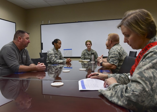 Lt. Col. Elizabeth Beal, 19th Medical Operations Squadron commander, is briefed on the situation of a medical group exercise August 24, 2017 at Little Rock Air Force Base, Ark. The exercise had an emphasis on readiness. (U.S. Air Force photo by Airman Rhett Isbell)