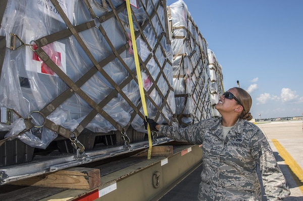 Staff Sergeant Paige Sanchez, 502nd Logistics Readiness Squadron, ensures pallets loaded with medical supplies and equipment are secure