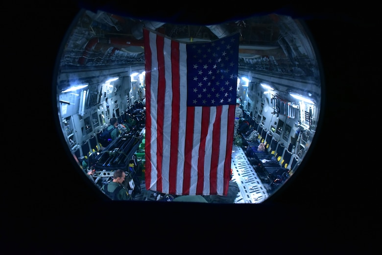 An American flag hangs in a C-17.