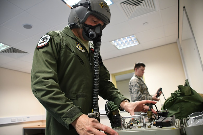 U.S. Air Force Lt. Col. Christopher Hawn, 489th Bomb Group deputy commander, tests his oxygen mask at RAF Fairford, U.K., Aug. 29, 2017.
