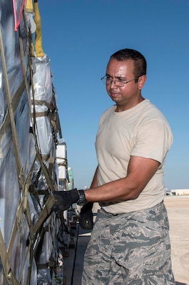 Staff Sergeant Eric Reyes, Air Medical Operations Agency, ensures pallets loaded with medical supplies and equipment are secure