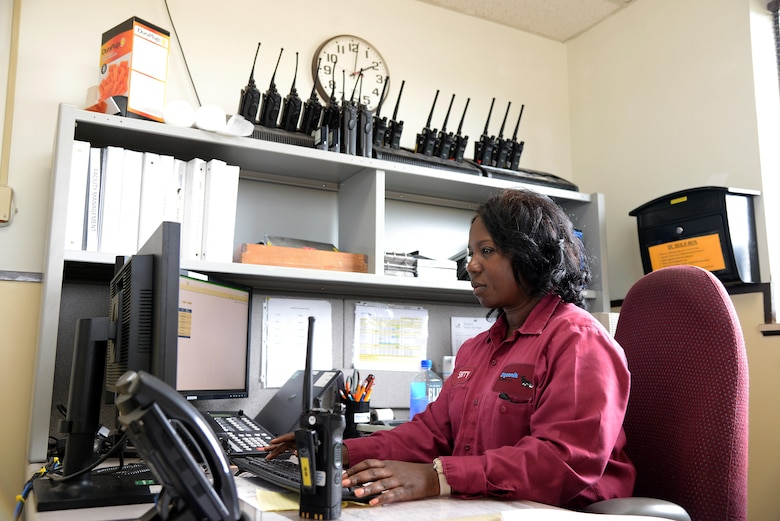 Sherry Voncee', 14th Logistics Readiness Squadron fuels controller, listens to a request from the flightline to refuel an aircraft Aug. 28, 2017, on Columbus Air Force Base, Mississippi. She is in charge of all movement of fuels across the base and manages over 10 vehicles almost constantly throughout the day. (U.S. Air Force photo by Airman 1st Class Keith Holcomb)