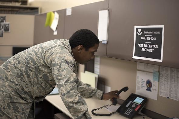 U.S. Air Force Airman 1st Class Amal Bonner, medical records technicians assigned to the 6th Medical Support Squadron, picks up the phone to talk to a customer at MacDill Air Force, Fla., Aug. 31, 2017.