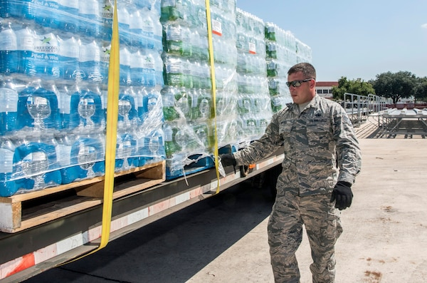 Staff Sgt. James Brush, 502nd Logistics Readiness Squadron, prepares for transport over 30,000 water bottles Aug. 30, 2017 at Joint Base San Antonio-Lackland, Texas.