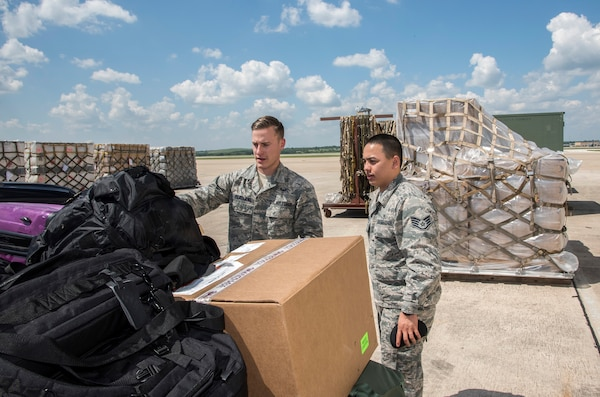 Airmen from the 59th Medical Wing prepare deployment bags for transport Aug. 30, 2017 at Joint Base San Antonio-Lackland, Texas.