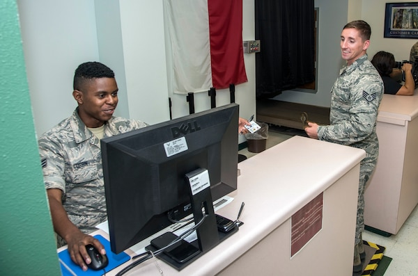 Senior Airmen Dominick Corbin, 502nd Logistics Readiness Squadron, processes Air Force medical personnel from Joint Base San Antonio-Lackland, Texas.