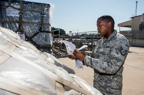 Tech. Sgt. Lloyd Brock, Air Force Medical Operations Agency, matches paperwork to pallets loaded with medical supplies and equipment Aug. 30, 2017, at Joint Base San Antonio-Lackland, Texas.