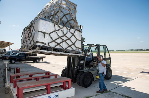 502nd Logistics Readiness Squadron personnel load pallets containing medical supplies and equipment Aug. 30, 2017 at Joint Base San Antonio-Lackland, Texas.