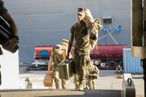 Marines with the 26th Marine Expeditionary Unit, II Marine Expeditionary Force, come aboard the amphibious assault ship USS Kearsarge.