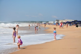 Children enjoy the surf of the Atlantic Ocean in Montauk, New York, August 16,2017. The wider beach is a secondary benefit of a recently-completed flood-control project reducing risk to the community and its residents.