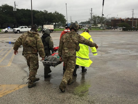 123rd STS Airmen evacuate a casualty of Hurricane Harvey.