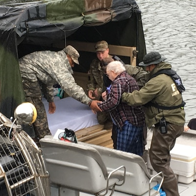 Louisiana National Guard members from the 256th Infantry Brigade Combat Team assist the Louisiana State Police, the Louisiana Department of Wildlife and Fisheries and Flordia Fish and Wildlife Conservation Commission with the evacuation of a nursing home in Orange, Texas, Aug. 30, 2017. Louisiana National Guard photo