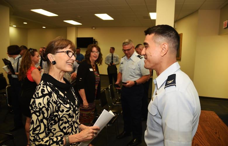 U.S. Air Force Col. Ricky Mills, 17th Training Wing commander, and Dr. Cheryl Sparks, Howard College president, discuss Public-Public and Public-Private program opportunities after the triannual P4 update meeting held at Judge Edd B. Keyes Building in San Angelo, Aug. 31, 2017.  P4 is a military installation and local community initiative to form partnerships that achieve value and benefit for both. (U.S. Air Force photo by Robert D. Martinez/Released)