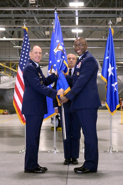 Lt. Gen. Lee K. Levy II, Air Force Sustainment Center commander, passes the guidon to Brig. Gen. Stacey T. Hawkins, incoming Ogden Air Logistics Complex commander, during a change of command ceremony at Hill Air Force Base, Utah, Aug. 31, 2017. (U.S. Air Force photo by Todd Cromar)