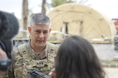 Army Lt. Gen. Stephen J. Townsend, commander of Operation Inherent Resolve, speaks with a reporter.