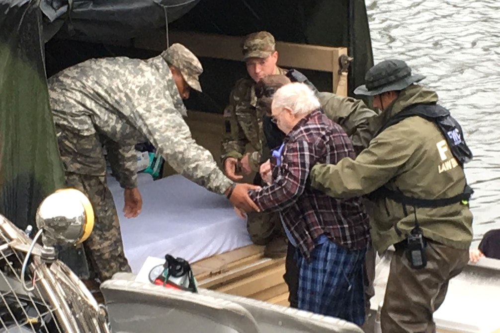 Louisiana National Guard members from the 256th Infantry Brigade Combat Team assist the Louisiana State Police, the Louisiana Department of Wildlife and Fisheries and Flordia Fish and Wildlife Conservation Commission with the evacuation of a nursing home in Orange, Texas