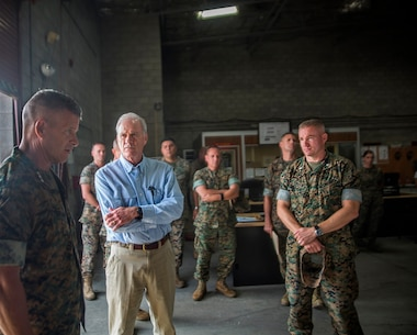 U.S. Marine Lt. Gen. Lewis Craparotta, the commanding general for the 1st Marine Expeditionary Force, explains the capabilities of the reparable management company to Richard Spencer, the Secretary of the Navy, on Camp Pendleton, Calif., August 30, 2017. Spencer previously served as a Marine Aviator for five years flying a CH-46 Sea Knight transport helicopter. (U.S. Marine Corps photo by Lance Cpl. Adam Dublinske)