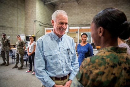U.S. Marines with 1st Maintenance Battalion, Combat Logistics Regiment 15, 1st Marine Logistics Group, meet Richard Spencer, the Secretary of the Navy, and discuss their roles and responsibilities on Camp Pendleton, Calif., August 30, 2017. Spencer visited Naval Base San Diego, Calif., and the USS Gabrielle Giffords on August 29, 2017. (U.S. Marine Corps photo by Lance Cpl. Adam Dublinske)