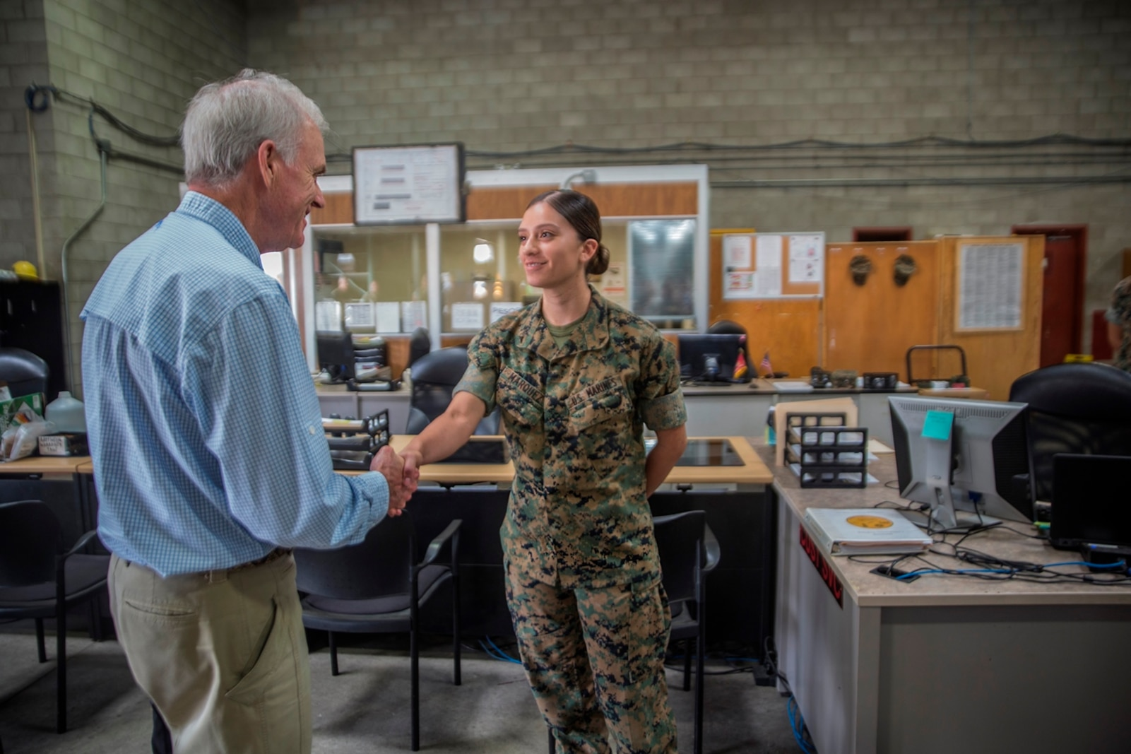 Richard Spencer, the Secretary of the Navy, greets Lance Cpl. Tatiana Marquez, a warehouse clerk with 1st Maintenance Battalion, Combat Logistics Regiment 15, 1st Marine Logistics Group, on Camp Pendleton, Calif., August 30, 2017. Spencer toured 1st Maintenance Battalion and talked to Marines about their capabilities and accomplishments. (U.S. Marine Corps photo by Lance Cpl. Adam Dublinske)
