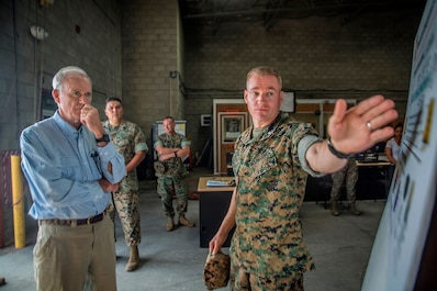 U.S. Marine Lt. Col. Foster Ferguson, the battalion commander with 1st Maintenance Battalion, Combat Logistics Regiment 15, 1st Marine Logistics Group, explains the capabilities of the reparable management company to Richard Spencer, the Secretary of the Navy, on Camp Pendleton, Calif., August 30, 2017. 1st Maintenance Battalion received their 3-D printer known as an expeditionary manufacturer in August 2016. (U.S. Marine Corps photo by Lance Cpl. Adam Dublinske)
