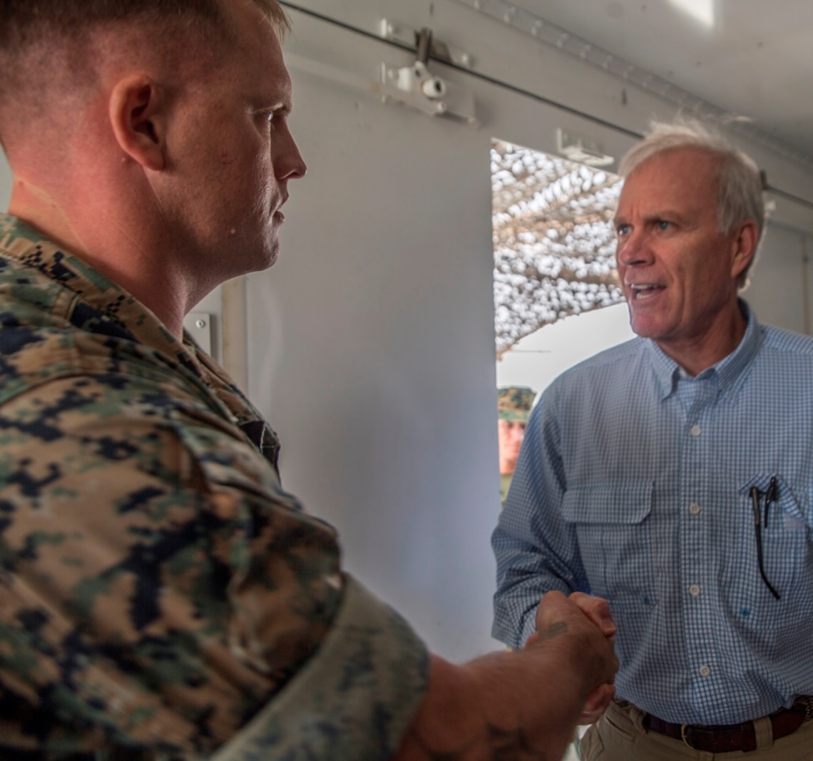 U.S. Marine Staff Sgt. Wesley Jones, an optics technician with 1st Maintenance Battalion, Combat Logistics Regiment 15, 1st Marine Logistics Group, meets with Richard Spencer, the Secretary of the Navy, on Camp Pendleton, Calif., August 30, 2017. Spencer toured 1st Maintenance Battalion and talked to Marines about their capabilities and accomplishments. (U.S. Marine Corps photo by Lance Cpl. Adam Dublinske)
