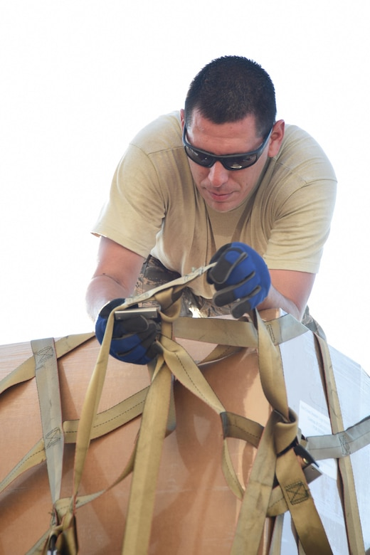 Air Force Tech. Sgt. Lucas Ortega, 73rd Aerial Port Squadron cargo supervisor, adjusts webbing on a pallet used to secure American Red Cross supplies before their transport August 29, 2017, at Naval Air Station Fort Worth Joint Reserve Base, Texas, in support of Hurricane Harvey relief efforts. There were 90,000 lbs. of supplies, included blankets and cots, sent as part of the Defense Support of Civil Authority. Department of Defense provides medium and heavy lift rotary wing assets, along with ground transportation, to move personnel, commodities and equipment within Texas. (U.S. Air Force photo by Ms. Julie Briden-Garcia)