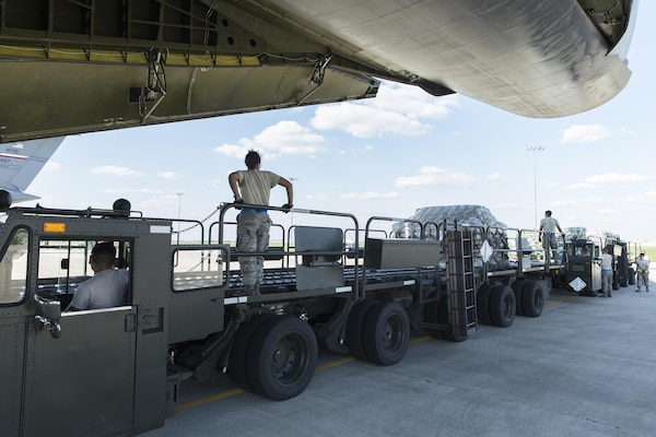 U.S. Air Force Personnel with 502nd Logistics Readiness Squadron load supplies and equipment on a military aircraft